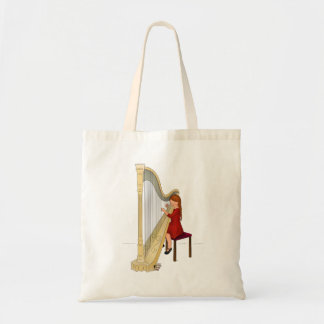 Child playing harp tote bag