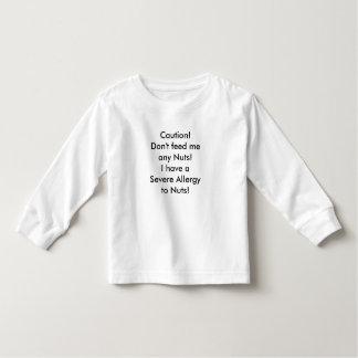Child Shirt nut allergy message.
