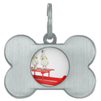 Children christmas figurines on red sleigh pet name tag