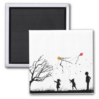 Children flying kites magnet