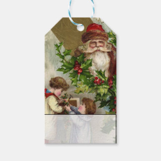Children Hanging Holly With Vintage Santa Claus Gift Tags