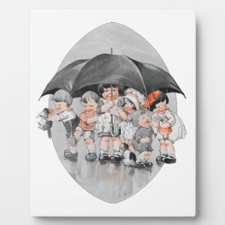 Children Playing in the Rain Holding Umbrellas Plaque