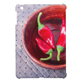 Chilli hot red pepper in a brown wooden bowl iPad mini case
