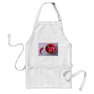 Chilli hot red pepper in a brown wooden bowl standard apron
