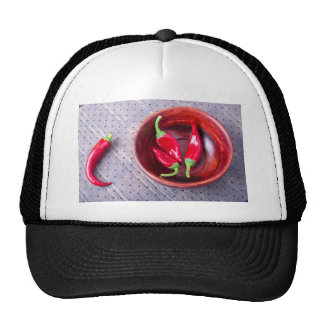 Chilli hot red pepper in a brown wooden bowl trucker hat