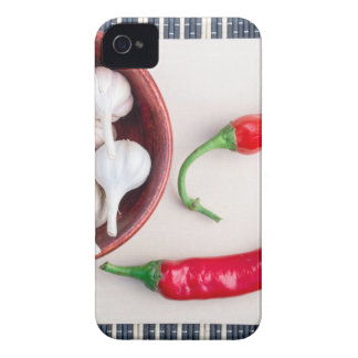Chilli peppers and garlic in a wooden bowl Case-Mate iPhone 4 cases