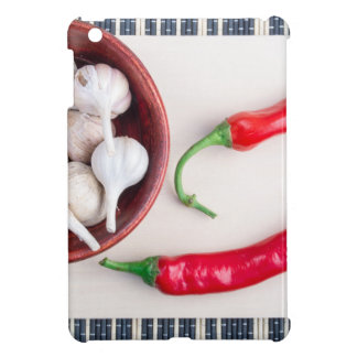 Chilli peppers and garlic in a wooden bowl iPad mini case