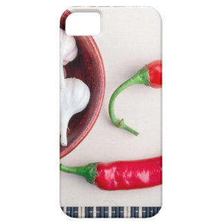 Chilli peppers and garlic in a wooden bowl iPhone 5 cases