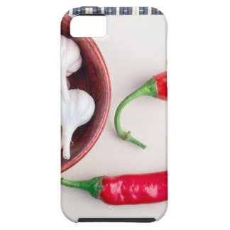 Chilli peppers and garlic in a wooden bowl iPhone 5 covers