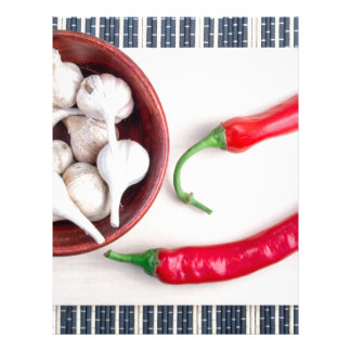 Chilli peppers and garlic in a wooden bowl letterhead