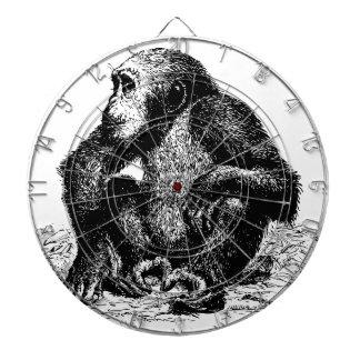 chimpanzee dartboard with darts