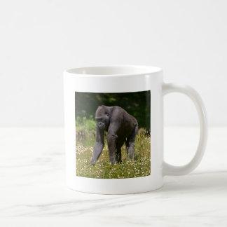 Chimpanzee in the flowering grass coffee mug