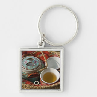 China, Hong Kong. Traditional Chinese teapot & 3 Silver-Colored Square Keychain