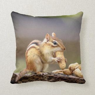 Chipmunk eating a peanut throw pillow
