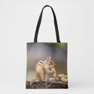 Chipmunk eating a peanut tote bag