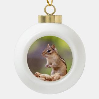 Chipmunk with peanuts ceramic ball christmas ornament