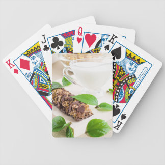 Chocolate bar with a cereal and milk for breakfast bicycle playing cards