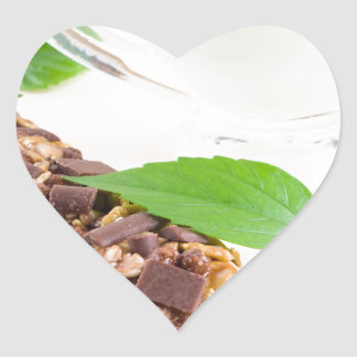 Chocolate bar with a cereal and milk for breakfast heart sticker
