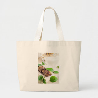 Chocolate bar with a cereal and milk for breakfast large tote bag