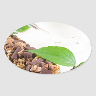 Chocolate bar with a cereal and milk for breakfast oval sticker