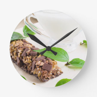 Chocolate bar with a cereal and milk for breakfast round clock