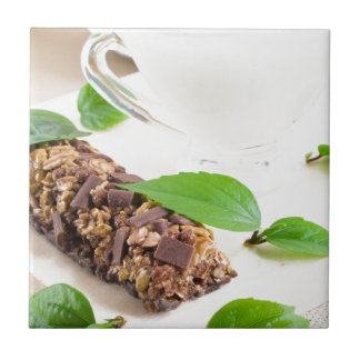 Chocolate bar with a cereal and milk for breakfast tile