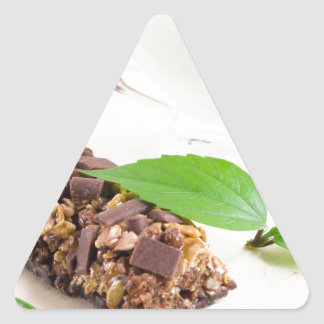 Chocolate bar with a cereal and milk for breakfast triangle sticker
