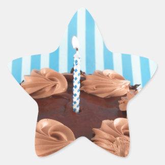 Chocolate birthday cake with blue background star sticker