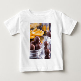 Chocolate candies in a small glass bowl close-up baby T-Shirt
