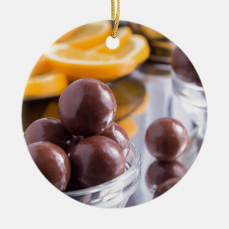 Chocolate candies in a small glass bowl close-up ceramic ornament
