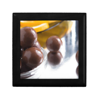 Chocolate candies in a small glass bowl close-up gift box