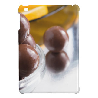 Chocolate candies in a small glass bowl close-up iPad mini cases