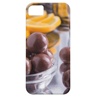 Chocolate candies in a small glass bowl close-up iPhone 5 case