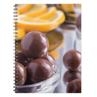 Chocolate candies in a small glass bowl close-up notebook