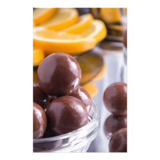 Chocolate candies in a small glass bowl close-up stationery