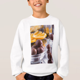Chocolate candies in a small glass bowl close-up sweatshirt