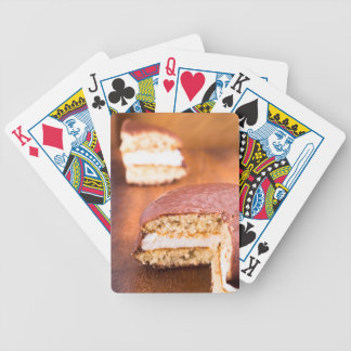 Chocolate cookies with milk souffle on a brown bicycle playing cards