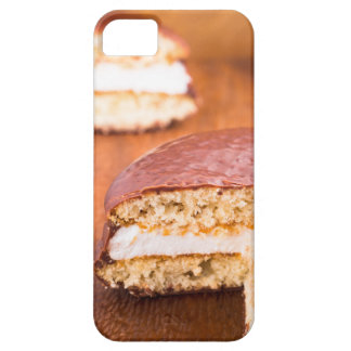 Chocolate cookies with milk souffle on a brown iPhone 5 cover