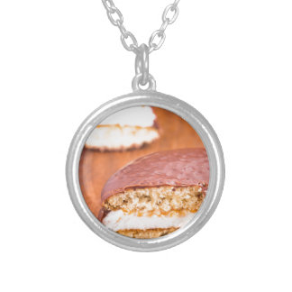 Chocolate cookies with milk souffle on a brown silver plated necklace