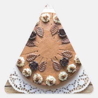 Chocolate cream pie on rustic wood cake top triangle sticker