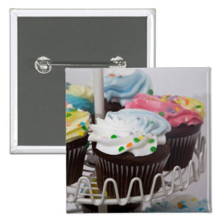 Chocolate cupcakes on a cake stand 2 2 inch square button
