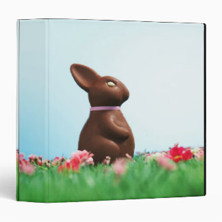 Chocolate Easter bunny amongst flowers in grass, Vinyl Binder