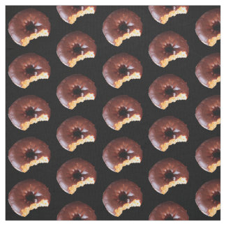 Chocolate Frosted Yellow Cake Donuts on Black Fabric