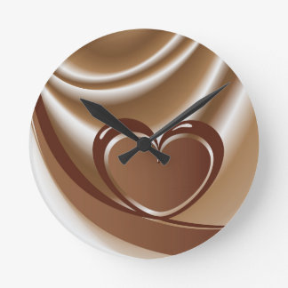 Chocolate heart from a tape in the background of m clocks