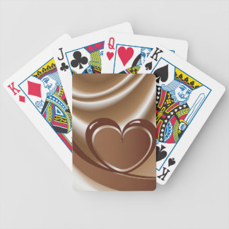 Chocolate heart from a tape in the background of m poker deck