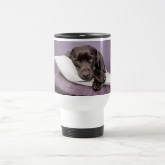 Chocolate labrador retriever dog sleepy on pillows travel mug