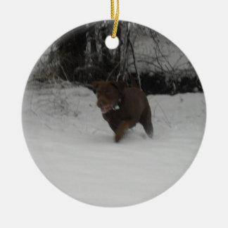 Chocolate Labrador Retriever in the snow Ceramic Ornament
