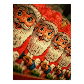 Chocolate Santas in a row, candy Postcard