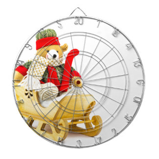 Christmas bear in wooden sleigh on white dartboard