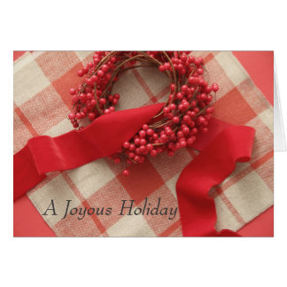 Christmas berries and wreath on plaid card